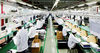 рабочие нафабрике Foxconn, © Tony Law/wir...